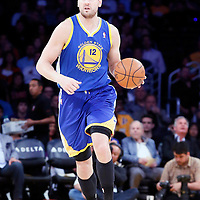 11 April 2014: Golden State Warriors center Andrew Bogut (12) brings the ball up court during the Golden State Warriors 112-95 victory over the Los Angeles Lakers at the Staples Center, Los Angeles, California, USA.