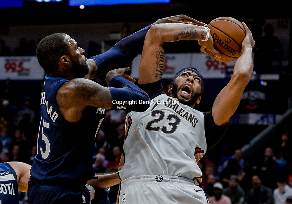 Nov 1, 2017; New Orleans, LA, USA; New Orleans Pelicans forward Anthony Davis (23) is defended by Minnesota Timberwolves guard Shabazz Muhammad (15) during the second half of a game at the Smoothie King Center. The Timberwolves defeated the Pelicans 104-98. Mandatory Credit: Derick E. Hingle-USA TODAY Sports