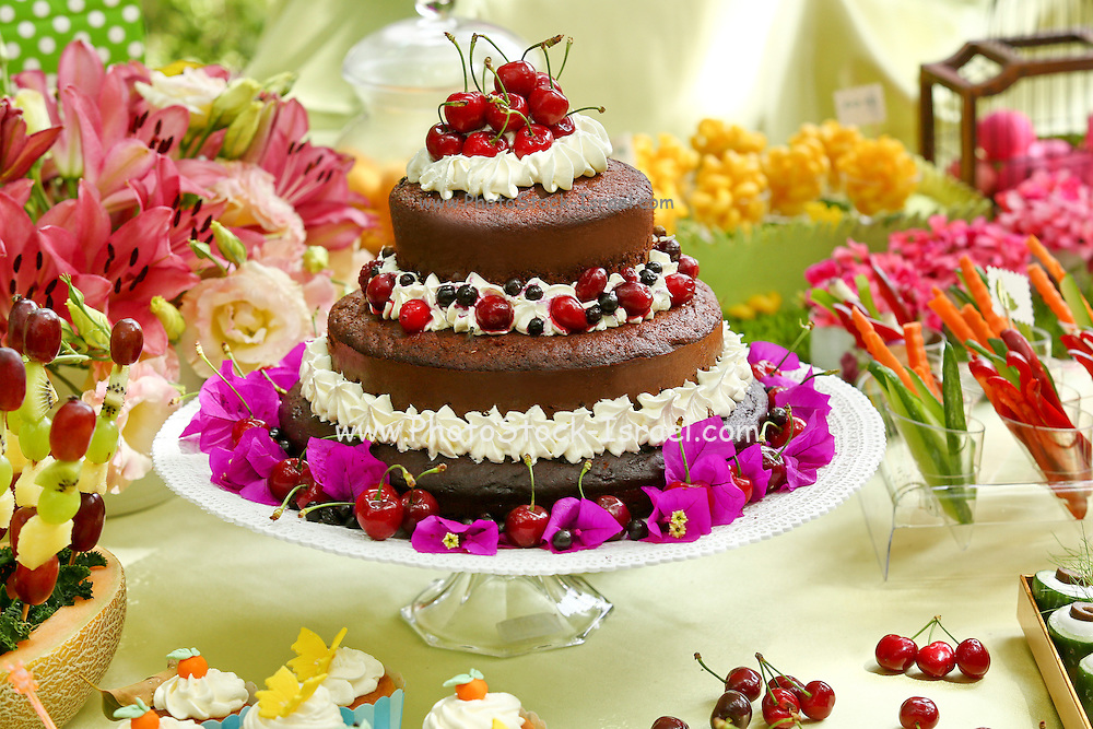 Layer cake decorated with whipped cream and cherries. This image has a restriction for licensing in Israel