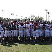 The teams huddle up prior to warm-ups during the practice session at the Walt Disney Wide World of Sports Complex in preparation for the Under Armour All-America high school football game on December 3, 2011 in Lake Buena Vista, Florida. (AP Photo/Alex Menendez)
