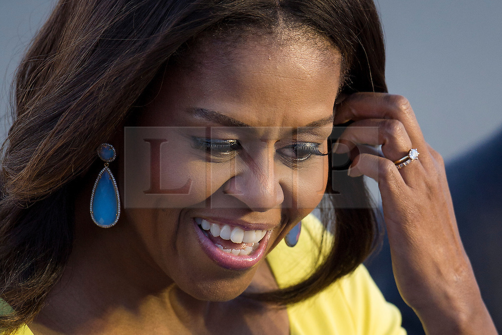 © Licensed to London News Pictures. 15/06/2015. Stansted, UK. First Lady MICHELLE OBAMA speaking to the families of US servicemen who live in the UK as she arrives in the UK at Stansted Airport accompanied by her daughters Malia and Sasha for the start of a three day visit to the UK. During the visit the First Lady and her family will meet with students at Mulberrry School for Girls and have Tea with Prime Minister David Cameron and Samantha Cameron. Photo credit: Ben Cawthra/LNP