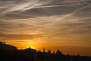 The sun rises over the skyline of downtown Paris.