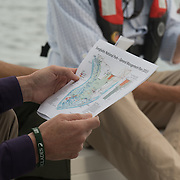 FLORIDA CITY, FLORIDA - APRIL 22, 2016<br /> Sally Jewell, United States Secretary of the Interior, holds a printed breakdown of the areas affected while riding on  U.S. Parks Service boat in the waters of the Everglades National Park while looking at dying sea grass in the waters of the park. <br /> (Photo by Angel Valentin)