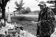 """Randy Weaver, whom rents property in Union Springs sells his collection of various glass vessels –including antique nursing bottles during the annual """"50 Mile Yardsale"""", Saturday, July 20, 2016 along Route 90 in the Cayuga Lake region of the Finger Lakes, New York. Mr. Weaver acquires most of his collectibles from the internet."""
