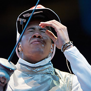 Miles Chamley-Watson of the United States reacted to losing a touch point against Egypt's Alaaeldin Abouelkassem in the round of 32 in the men's foil individual competition at the ExCel centre during the 2012 Summer Olympic Games in London, England, Tuesday, July 31, 2012. (David Eulitt/Kansas City Star/MCT)