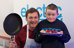 NO REPRO FEE: (L-R) Shane Ryan (9) from Tipperary Celebrity is pictured with MasterChef winner David Gillick was cooking up a storm at the Electric Ireland stand at the 2013 National Ploughing Championships yesterday. With three showcase demonstrations each day, David is creating some of his favourite healthy dishes for visitors to the Electric Ireland stand.