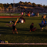 Children play as families gather on the turf to wait for the fireworks display during the annual Fourth of July Party in the Park Monday in Gallup.