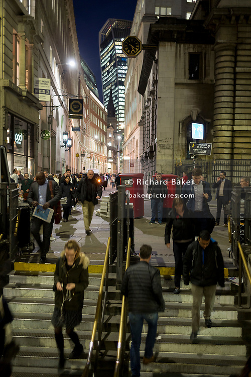 Blurred commuters enter the Underground Station entrance at Bank, on the corner of Lombard and King William Streets in the heart of the Square Mile, the capital's historical and financial centre, on 1st November 2017, in the City of London, England.