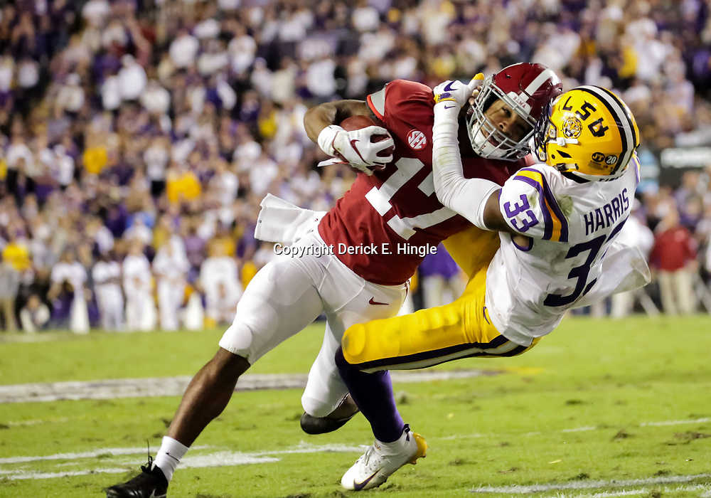 Nov 3, 2018; Baton Rouge, LA, USA; Alabama Crimson Tide wide receiver Jaylen Waddle (17) is tackled by LSU Tigers safety Todd Harris Jr. (33) during the second quarter at Tiger Stadium. Mandatory Credit: Derick E. Hingle-USA TODAY Sports