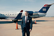 HUNTSVILLE, AL – APRIL 2, 2014: Executive Director Rick Tucker stands on the tarmac at Huntsville International Airport. In an attempt to reverse the trend of declining service by airlines in small airports, Huntsville International Airport attempted to implement a rebate plan that would offer incentives to some carriers for enhanced service to the midsize city. The Federal Aviation Administration cautioned that the plan could potentially violate a federal law barring interference with airline fares, routes or service levels. When the industry's largest trade group, Airlines for America, threatened to, the airport's plan was disrupted. As major airlines continue to trim service offerings in smaller, less profitable cities, airports like Huntsville International struggle to attract and maintain carriers. CREDIT: Bob Miller for The Wall Street Journal<br />