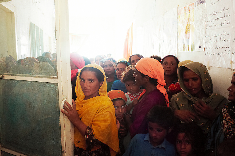 Patients wait to be treated at the Mitho Barbar government health clinic in Dadu, Sindh, Pakistan on July 4, 2011.