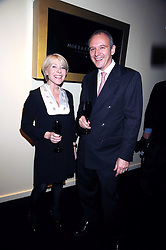 GILLY MACKWOOD and GRAHAM BOYES at the opening of the Atelier Moet pop-up boutique, 70 New Bond Street, London on 3rd December 2008.