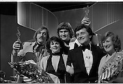1980-03-09.9th March 1980.09-09-1980.03-09-80..Photographed at RTE Montrose, Dublin..What's Another Year..From Left:..Shay Healey, who wrote the winning song What's Another Year..Johnny Logan, centre), the winning singer..Larry Gogan, (fourth from left), Compere.