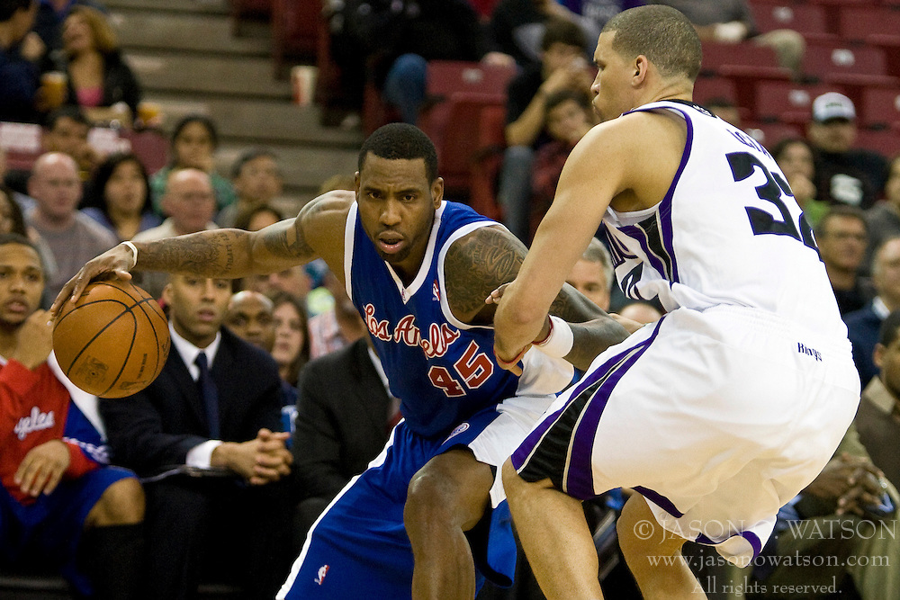 February 28, 2010; Sacramento, CA, USA;  Los Angeles Clippers guard Rasual Butler (45) is guarded by Sacramento Kings guard Francisco Garcia (32) during the second quarter at the ARCO Arena.  Sacramento defeated Los Angeles 97-92.