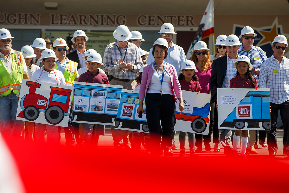 Yvonne Chan, founding Principal, walks with students and officials before a ribbon cutting celebration at Vaughn Next Century Learning Center on Friday, April 21, 2017 in San Fernando, Calif. A new project will provide upgraded classrooms on an L.A. Unified campus that hosts a charter school, replacing 21 old portable classrooms with new construction classrooms made with recycled shipping containers. © 2017 Patrick T. Fallon