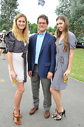Left to right, YASMIN LE BON, England football manager FABIO CAPELLO and AMBER LE BON at a charity polo match organised by Jaeger Le Coultre was held at Ham Polo Club, Richmond, Surrey on 12th June 2009.