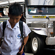 MANILA (Philippines). 2009. A boy going to school in the streets of Manila.