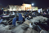 DETROIT - DECEMBER 6: Demonstrators lie down in front of the DIA for a die-in protest during Noel Night on Saturday December 6, 2014 in Detroit. People were protesting against recent police treatment of minorities, including the decision by a New York grand jury not to indict a police officer in the chokehold death of Eric Garner, an unarmed African-American man. (Photo by Bryan Mitchell/Special to The Detroit News)