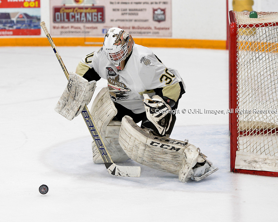 TRENTON, ON  - APR 15,  2017: Ontario Junior Hockey League, Championship Series.  Georgetown Raiders vs the Trenton Golden Hawks in Game 2 of the Buckland Cup Final.  Elliot Gerth #30 of the Trenton Golden Hawks tracks the puck during the second period.<br /> (Photo by Shawn Muir / OJHL Images)