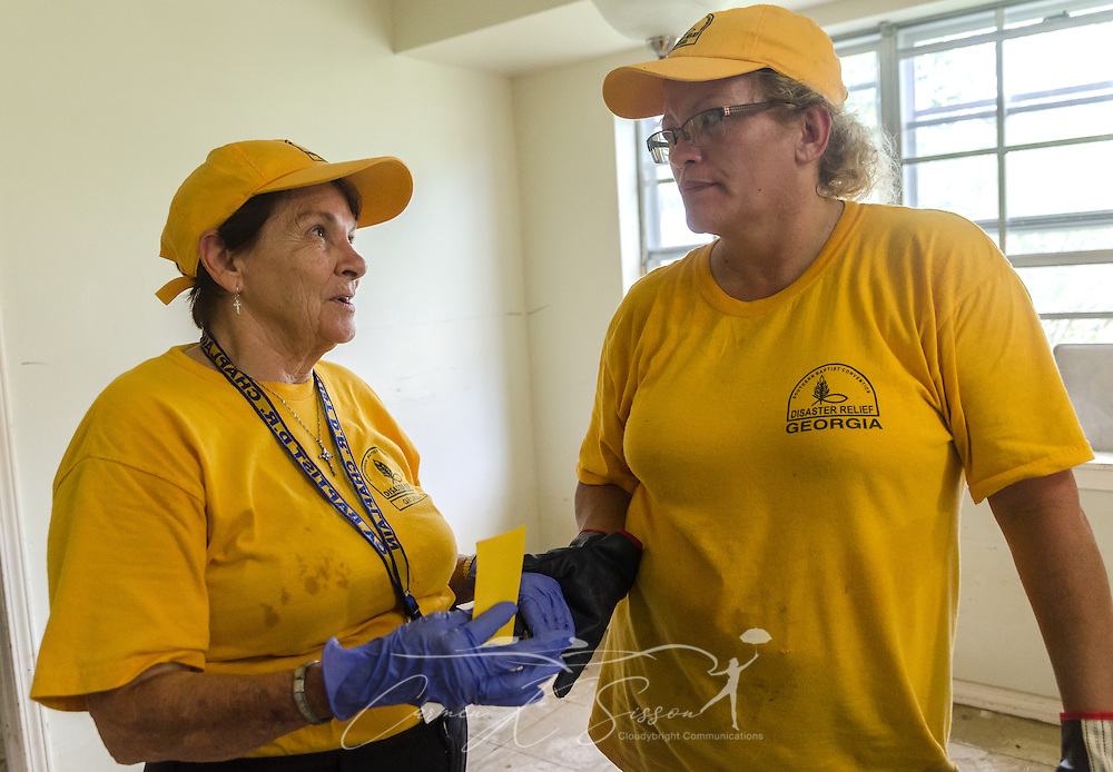 Southern Baptist Disaster Relief chaplain Joan Sangster, of Calvary Baptist Church in Jesup, Ga., talks with Kim Rowland, of East Dublin Dayspring Worship Center in East Dublin, Ga., Aug. 26, 2016, in Denham Springs, La. Sangster and Rowland, along with other SBDR Georgia volunteers, are helping mud out the flood-damaged house. The homeowners are among thousands of Louisiana residents affected by a mid-August flood. (Photo by Carmen K. Sisson)