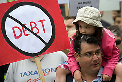 © licensed to London News Pictures. 14/05/2011. London, UK. Paul Staines (aka Guido Fawkes) with his daughter at The Rally Against Debt held in Westminster. London today (14/05/2011). Organisers of the pro-cuts demonstration include the Taxpayers' Alliance group. Please see special instructions for usage rates. Photo credit should read Ben Cawthra/LNP
