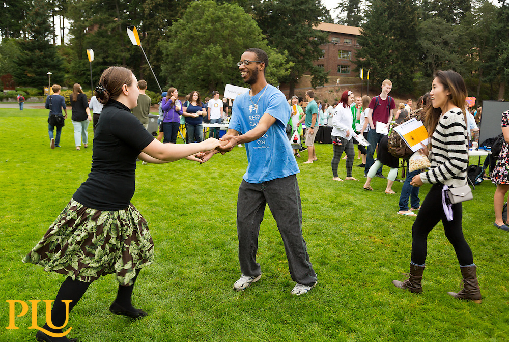 Swing Dance Club members putting on a demonstration during the Involvement fair following Fall Convocation at PLU Monday, Sept. 8, 2014. (Photo/John Froschauer)