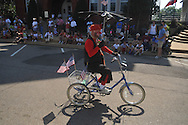 John Arrechea rides a bike in the 4th of July parade in Oxford, Miss. on Monday, July 4, 2011.