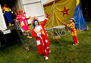 Jahirt Bermudez, of Colombia, South America, who performs as Perolito the clown for the Cole Bros. Circus, leads the clown troupe to the big top.