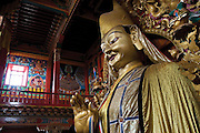 19 February 2007 - Shangarila, Yunnan - A huge statue of a Buddha dominates one of the main halls of the vast Tibetan monastic complex of Songzhalin. Photo credit: Luke Duggleby
