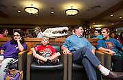 Alexandra Pinhasi, left, Chase Vogel, left center, Dan Inman, right center, and Jordan Duckett, right sit front row for Professor Witmer's presentation on Dinosaur anatomy during Science Cafe at The Front Room on September 25, 2013.
