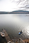 Schroon Lake in the Adirondack Mountains, NY state. Peter Menzel kayaking. MODEL RELEASED.