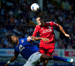 LIVERPOOL, ENGLAND - Saturday, October 1, 2011: Liverpool's Andy Carroll in action against Everton's Sylvain Distin during the Premiership match at Goodison Park. (Pic by David Rawcliffe/Propaganda)