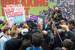 "Smith Square, Westminster, London, June 16th 2016. UKIP leader Nigel Farage launches his ""biggest ever"" advertising campaign as Leave and Remain enter their last week of campaigning before the EU referendum on June 23rd. PICTURED: A Remain campaigner's poster declares that UKIP will privatise the NHS."