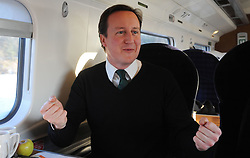 Leader of the Conservative Party David Cameron answering questions to Glamour Editor Jo Elvin questions as they travel by train to Liverpool,  Friday January 8, 2010. Photo By Andrew Parsons / i-Images.