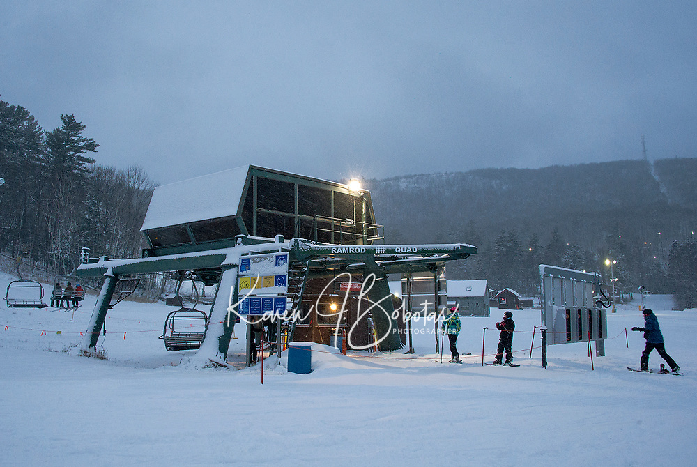 Skiers and riders load the Ramrod Quad to enjoy some fresh snow at Gunstock on Tuesday evening.  (Karen Bobotas/for the Laconia Daily Sun)