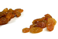 Studio shot of raisins on white background
