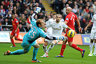 Liverpool's Jose Enrique ® has a header saved by Swans keeper Gerhard Tremmel. Barclays Premier league, Swansea city v Liverpool at the Liberty Stadium in Swansea , South Wales on Sunday 25th November 2012. pic by Andrew Orchard, Andrew Orchard sports photography,