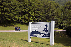 A motorcycle rides up the entrance to the Blue Ridge Parkway at US 19, Haywood and Jackson County line, North Carolina, July 8, 2008