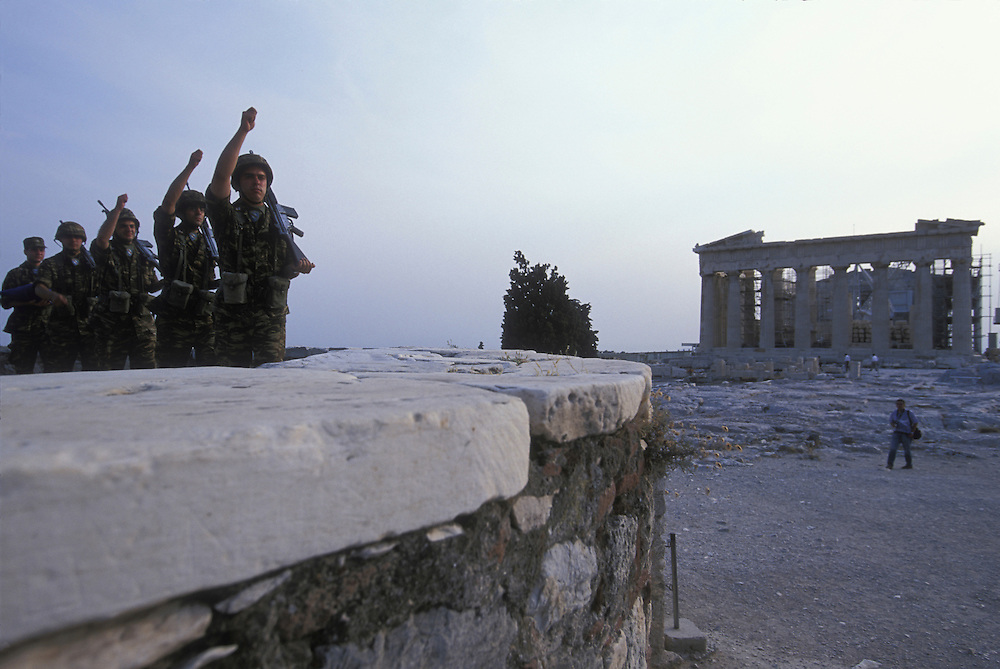 Europe, Greece, Athens, Greek Army color guard during flag lowering ceremony at sunset at the site of the ancient Acropolis