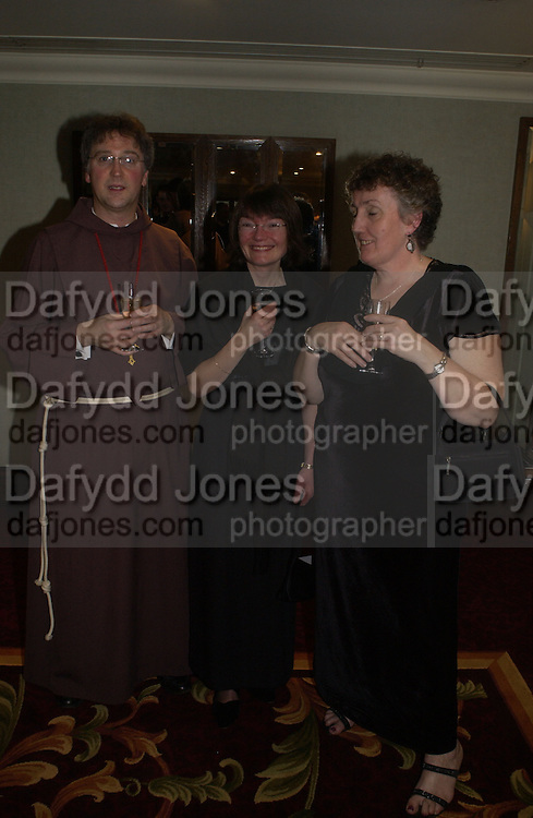 Rev. Michael Seed, Gemma Blundell and Mary Carroll. White Knights Ball, Grosvenor House. Park Lane. London. 6  January 2006. ONE TIME USE ONLY - DO NOT ARCHIVE  © Copyright Photograph by Dafydd Jones 66 Stockwell Park Rd. London SW9 0DA Tel 020 7733 0108 www.dafjones.com
