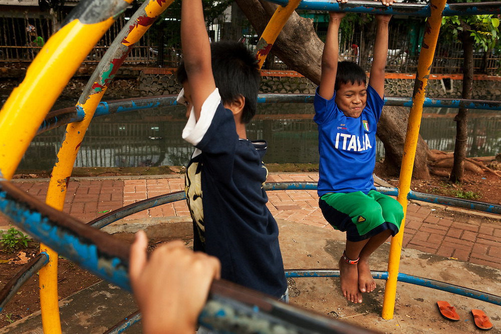 Boys play in the small playground in Tambor, Jakarta, Indonesia.
