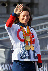 © Licensed to London News Pictures. 18/10/2016. London, UK. Multiple gold medal winner cyclist SARAH STOREY waves to the crowd as Olympic and Paralympic athletes, who competed in the Rio 2016 Olympics receive hero's welcome in Trafalgar Square on Tuesday, 10 October 2016. Photo credit: Tolga Akmen/LNP