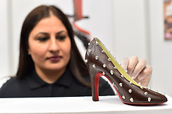 Azra Sadiq of Azra chocolates puts the finishing touches to a chocolate shoe, at The Chocolate Show, at Olympia in Kensington, London. Picture date: Friday October 13th, 2017. Photo credit should read: Matt Crossick/ EMPICS Entertainment.