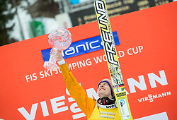 Overall World Cup winner Severin Freund of Germany celebrates with a globe during final trophy ceremony after the Ski Flying Individual Competition at Day 4 of FIS World Cup Ski Jumping Final, on March 22, 2015 in Planica, Slovenia. Photo by Vid Ponikvar / Sportida
