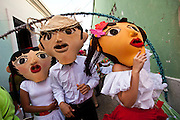 A costumed revelers parade during the Festival of San Sebastian in San Juan, Puerto Rico.