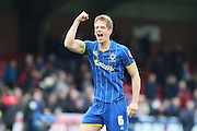 Paul Robinson defender for AFC Wimbledon (6) celebrates his goal during the Sky Bet League 2 match between AFC Wimbledon and Crawley Town at the Cherry Red Records Stadium, Kingston, England on 16 April 2016. Photo by Stuart Butcher.