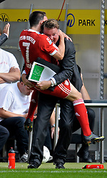Franck Ribery celebrates with Bayern Munich trainer Louis van Gaal during the Bundesliga match between  Borussia Dortmund and FC Bayern Munich, 12th September 2009.