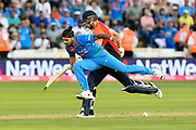 David Willey of England and Umesh Yadav of India clash during the International T20 match between England and India at the SWALEC Stadium, Cardiff, United Kingdom on 6 July 2018. Picture by Graham Hunt.