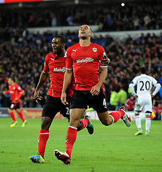 Cardiff City's Steven Caulker celebrates his goal with Cardiff City's Kevin Theophile Catherine - Photo mandatory by-line: Joe Meredith/JMP - Tel: Mobile: 07966 386802 03/11/2013 - SPORT - FOOTBALL - The Cardiff City Stadium - Cardiff - Cardiff City v Swansea City - Barclays Premier League