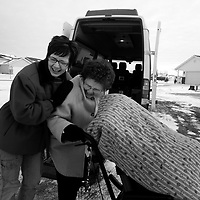 """Elaine wheels Malachi in from the cold after Laura Lindblad, left, drops him off from Heartland.""""I have faith in Malachi and Brainfingers,"""" she tells Lindblad. """"And I am just waiting for the day when I can ask him a question."""" But Elaine doesn't waver in her hope. Better than anyone, she can put Malachi's small strides in perspective. For the first time, he's gained a measure of control over his reality - even if it's over a small slice of it on a laptop screen."""